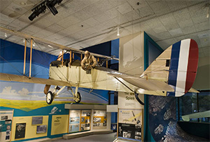 aircraft hanging above visitors in a gallery