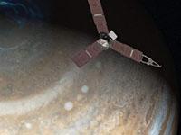Satellite flying over Jupiter on it's way to Juno