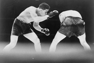 Joe Louis looks for an opening during boxing match with Max Schmeling. June 20, 1936. World-Telegram staff photo