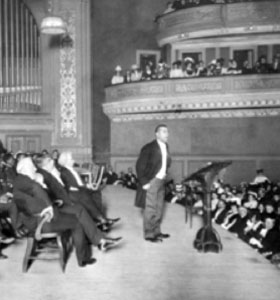 Booker T. Washington holds a Carnegie Hall audience spellbound during his Tuskegee Institute Silver Anniversary lecture, 1906. Mark Twain is seated just behind Mr. Washington. The New York Times photo archive.